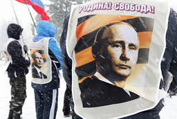 Participants wear vests depicting Russian President Putin during a support rally in Stavropol