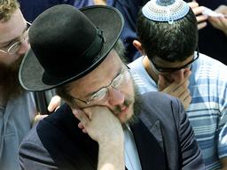 MOURNERS ATTEND A FUNERAL OF SCHIJVESCHUURDERS FAMILY IN JERUSALEM