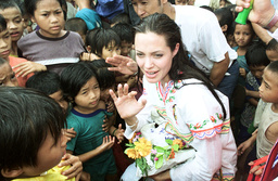 AMERICAN ACTRESS ANGELINA JOLIE RECEIVES GIFTS AT A REFUGEE CAMP IN THAM HIN
