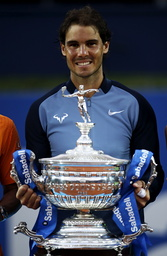 Rafael Nadal of Spain poses for media with the Barcelona Open trophy after defeating Kei Nishikori of Japan in Barcelona