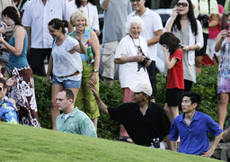 US President-elect Barack Obama waves to a crowd of onlookers after playing golf at Mid Pacific Country Club in Kailua, Hawaii.