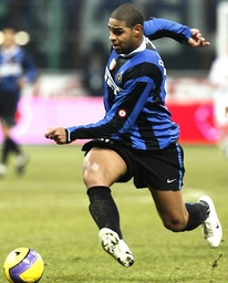 Inter Milan Adriano pushes the ball during the match against Atalanta during their Italian Serie A soccer match in Milan