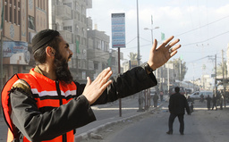 Palestinian rescue worker shouts after air strike in Rafah