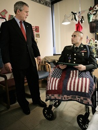 U.S. President George W. Bush stands with U.S. Army Cpl. Parsons at Walter Reed Army Medical Center