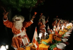 Lebanese Christian opposition dressed as Santa Claus celebrate Christmas day with a 40 metre-long cake near the government headquarters in central Beirut