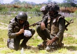 SRI LANKAN SOLDIERS REMOVE AN ANTI-PERSONNEL MINE IN MANKULAM