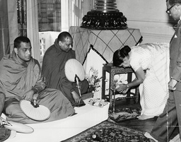 Mrs Sirimavo Bandaranaike Prime Minister Of Ceylon (now Sri Lanka) Lights The Coconut Oil Lamp At The Begining Of Today's Special Half-hour Service At The Buddhist Temple In Kensington. Box 699 1140716130 A.jpg.