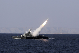New medium-range missile fires from naval ship during Velayat-90 war game on Sea of Oman near Strait of Hormuz in southern Iran