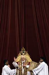 Pope Benedict XVI blesses his faithful as he leads his Urbi et Orbi message from the central balcony of Saint Peter's Square