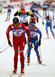 Northug of Norway crosses a finish line of the men's cross country 50 km mass start race at the Nordic World Championships in Liberec