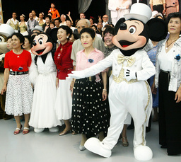 SENIOR CITIZENS POSE WITH MICKEY AND MINNIE MOUSE AT TOKYO DISNEYLAND IN URAYASU