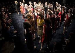 Models display creations by Prada during their Fall/Winter 2009/10 women's collection show at Milan Fashion Week