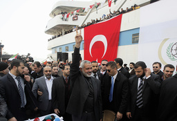 Hamas' Gaza leader Haniyeh flashes a victory sign to his supporters in front of the cruise liner Mavi Marmara in Istanbul