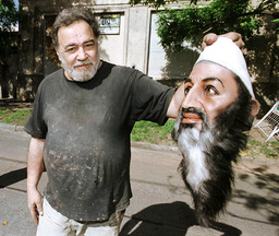 ARGENTINE MASK MAKER PANZA HOLDS UP A BIN LADEN CREATION