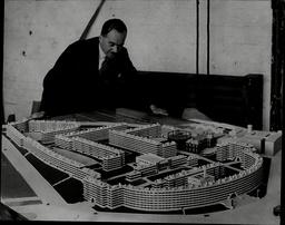 Mr Rah Livett Ariba With Model Of His Scheme For Quarry Hill Flats In Leeds.
