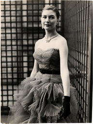 Eunice Gardiner Fifties Fashion Model. Picture Shows Eunice Gardiner Wearing A Strapless Net Gown In Purple With A Pleated Skirt. Born Eunice Bailey In Bexley Kent Eunice Was Discovered By A Talent Scout On The London Underground. She Went On To Beco