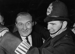 James Callaghan Is Assisted By A Police Officer After He Became Home Secretary.