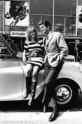 Girl Wearing What Appeared To The Wearing A Striped Football Jersey. This Is The Attire Chosen By Cartita The 20th Century Fox Discovery From Finland Who Was At The Airport To Meet In Hollywood Actor Don Murray Who Flew In For Costume Fitting - 1966