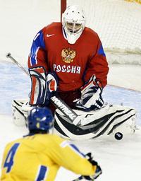 Russia's goalie Zhelobnyuk blocks a shot by Sweden's Hedman at the IIHF U20 World Junior Hockey Championships in Ottawa