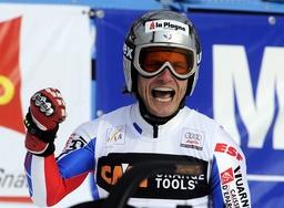 Winner Lizeroux of France celebrates in finish area after men's alpine skiing World Cup slalom race in Kranjska Gora