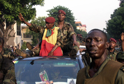 Coup leader Moussa Dadis Camara waves to crowds as he is driven through the streets of Conakry