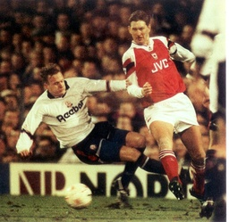 Fa Cup Match - Bolton's John Mcginlay Is Narrowly Beaten To A Cross By Arsenal Defender Tony Adams At Burnden Park Last Night. Final Score Bolton Wanderers 2 Arsenal 2