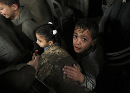 Palestinian relatives of Qanan wait for his funeral in Gaza