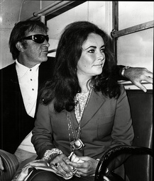 Actress Elizabeth Taylor And Husband Richard Burton Pictured At London Airport.