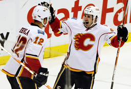 Calgary Flames leftwing Curtis Glencross celebrates with teammate Jarome Iginla after Iginla scored against the Detroit Red Wings during the second period of their NHL hockey game in Detroit,
