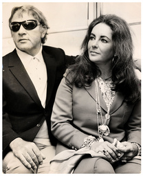 Elizabeth Taylor Actress Is Pictured With Her Fifth And Sixth Husband Actor Richard Burton (died August 1984) On Their Arrival At London's Heathrow Airport.
