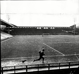 Liverpool Footballer Peter Thompson Running Round Anfield Football Ground.