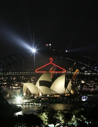 A pyrotechnic display on the Sydney Harbour Bridge in the shape of a coat hanger, the nickname given to the bridge, glows during New Year's eve celebrations