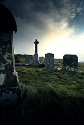 Celtic gravestone against clouds