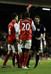 Arsenal's Djourou is sent off against Fulham during their English Premier League soccer match in London