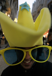 A boy wears a hat and a funny glasses as he waits for New Year's Eve festivities in Budapest