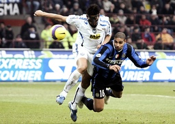 Inter Milan's Adriano (R) scores under the challenge of Atalanta's Moris Carrozzieri during their Italian Serie A soccer match at the San Siro stadium in Milan