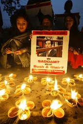 Activists from different non-governmental organizations (NGOs) light earthen lamps to protest in Lahore