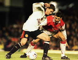 OLE GUNNAR FIGHTS FOR THE BALL WITH TONY ADAMS IN LONDON