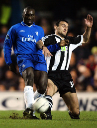 CHELSEA'S HASSELBAINK IS TACKLED BY NEWCASTLE UNITED'S DABIZAS