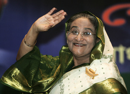 Bangladesh Awami League President and former PM Hasina waves as she leaves news conference in Dhaka