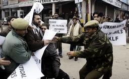Indian police officers detain leader of Jammu Kashmir Liberation Front in Srinagar
