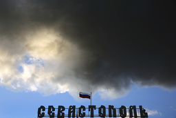 A Russian flag flutters over the Sevastopol hotel in the Crimean city of Sevastopol