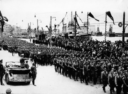 Hitler saluting marching storm troopers