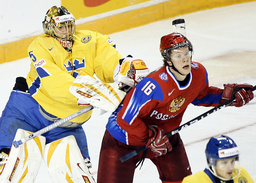 Sweden's Markstrom hits Russia's Andronov with his stick at the IIHF U20 World Junior Hockey Championships in Ottawa