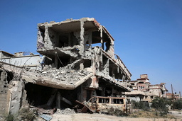 Buildings damaged during clashes between military forces loyal to Libya's eastern government and the Shura Council of Libyan Revolutionaries, are seen in Benghazi