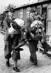 Members of the Reich Labour Service [Reichsarbeitsdienst, RAD] at their equipment with clothes, 1936
