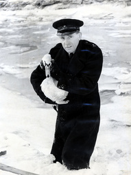 Inspector Pepper with a frozen Swan at Rye in Sussex, Britain - 1963