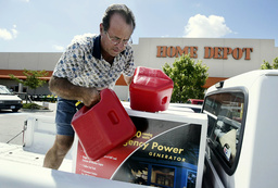 PETE SPANO AND OTHER NORTH CAROLINA RESIDENTS PREPARE FOR HURRICANE ISABEL