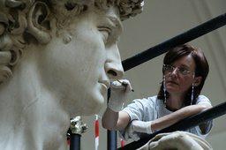 ITALIAN RESTORER CINZIA PARNIGONI CLEANS MICHELANGELO'S DAVID IN FLORENCE