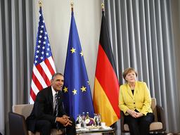 German Chancellor Merkel and U.S. President Obama pose before bilateral talks at Schloss Herrenhausen in Hanover